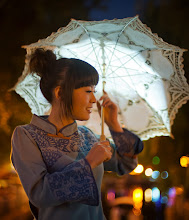 Photo: On Gossamer Wings... Traditional Chinese Girl With Parasol in Beijing, China  I had spent most of the day inside the Forbidden City, trying my best to find little bits here and there.  Tiny discoveries, you know.  I was pretty tired after a day of searching, but I still had barely enough energy to keep exploring into the night.  At that point, I decided to go to another, older area of the city.  There were hundreds of quaint shops, the smell of fresh food, families walking to and fro... it was all very nice.  I came to cross a little raised bridge, and I saw this woman standing there.  She was dressed in vintage Chinese grab and holding a delicate umbrella.  While talking with her friends, the light caught her umbrella just right, so I snapped a quick photo.   from Trey Ratcliff at www.stuckincustoms.com