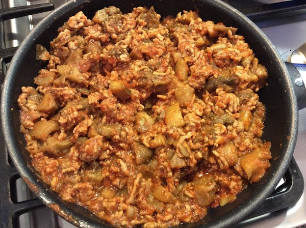 Increase heat and add ground meat to brown. Drain off excess fat and add...