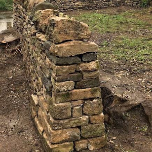 Duncan Burnell Prince of Walls built this 18 metre curved wall in Mendips