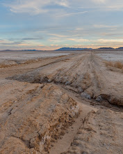 Photo: A broken road on a dry lake bed in the Mojave Desert