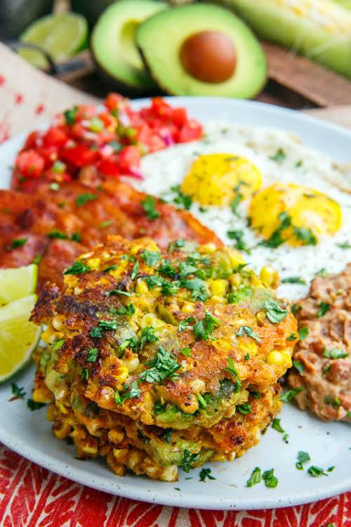 """Avocado and Cheddar Corn Cakes """"Corn cakes (or fritters) with coolant creamy..."""