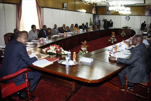 President Uhuru Kenyatta and Deputy President William Ruto during a Cabinet meeting at State House, Nairobi.