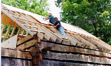 Photo: Dave and I sheathing the roof.
