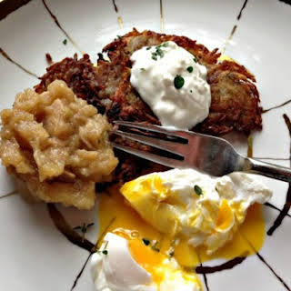 Potato Pancakes With Oven-Roasted Thyme Applesauce, Sour Cream, and Poached Eggs.