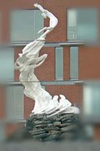"Photo: Statue representant une fibre de coton devant les gigantesques entrepots de ""Katoen....."""