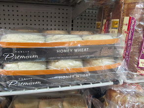 Photo: Publix Brand Honey Wheat English Muffins have 130 calories, as do Thomas' brand and Nature's Own.  All have the same caloric content.  Interesting, huh?