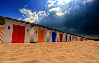 Photo: Good morning G+  This is a place called Woolacombe beach in North Devon with its row of beach huts that line the beach. I love the fact the doors are painted different colours and even though you can see rain clouds coming overhead people carry on no matter what. We have such a love hate relationship with the weather in the UK we have got to the point we just try to ignore the bad weather in the hope it will go away, it never does though!