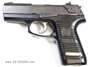 Photo: The Before restoration side view of the Ruger P95. A well worn and from outward appearance fully functional pistol.