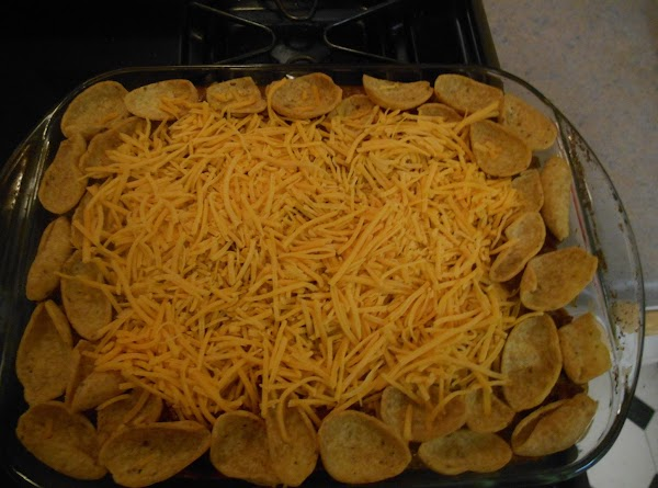 When done put the rest of the scoop fritos along the sides and add...