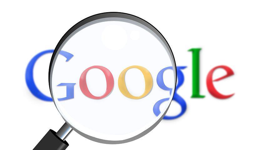 Logo Google avec loupe