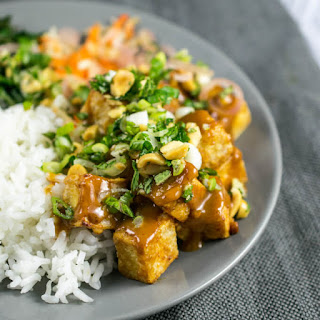 Crispy Baked Peanut Tofu with Pickled Shallots and Fresh Herbs.