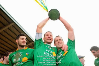 Photo: Damian Moran celebrates Leitrim's 2014 FBD league win with teammates Shane Foley and Feargal Glancy