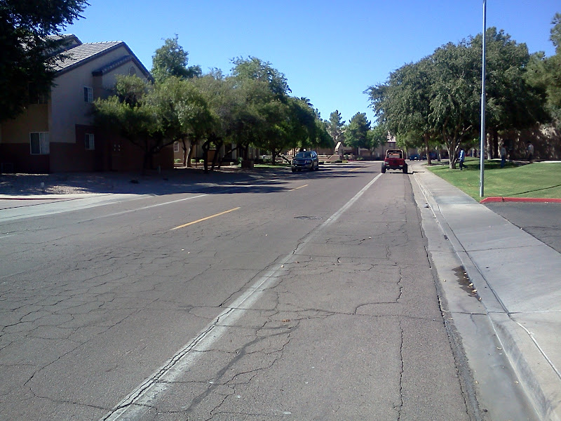 Photo: Wakial Loop in Phoenix. The stripe was added years ago; I imagine in an attempt to slow through traffic. The road serves as a cut-through for AM rush hour traffic between 48th ST and Warner Rd.