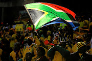 The new South African flag accompanied the birth of democracy in post-apartheid South Africa, while the country's old flag reminds black citizens of the oppression they overcame, says the Equality Court.