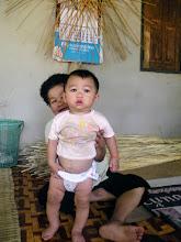 Photo: Baan Mae Ho: Charayu (10 months) and grandmother.