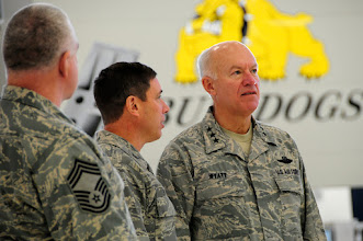 Photo: U.S. Air Force Lt. Gen. Harry Wyatt, Director of the Air National Guard, listens to Col. Frank Stokes, 148th Fighter Wing Commander, about the capabilities of the maintenance facility at the 148th Fighter Wing Air National Guard base in Duluth, Minn. Dec. 11th, 2009.  Lt. Gen Wyatt toured the guard base to better understand the facilities and mission capabilities at the wing. (U.S. Air Force photo by Master Sgt. Jason W. Rolfe)