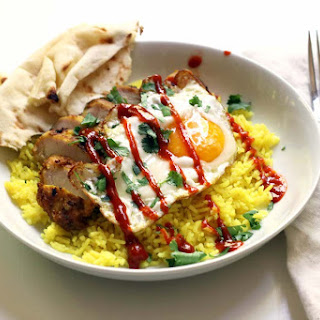 Indian Chicken and Turmeric Rice with a Fried Egg.