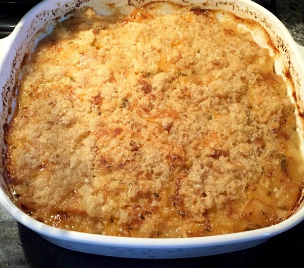 Mix breadcrumbs Parmesan cheese and melted  butter together. Sprinkle over casserole. Place casserole...