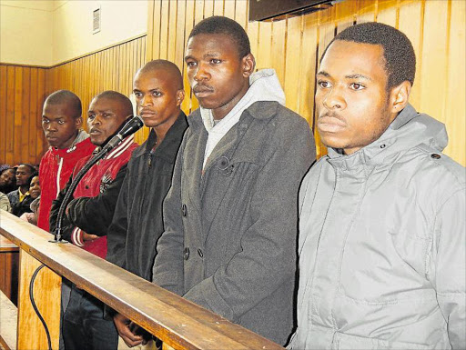 IN THE DOCK: Luthando Silwana, Lunga Khimbili, Zukile Danti, Siwaphiwe Maboleka and Philasande Kinase appeared in the Mthatha Magistrate's Court for the murder of deputy school principal Nodumo Mdleleni-Mzimane yesterday Picture: LOYISO MPALANTSHANE