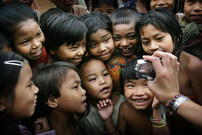 Photo: Bru children looking at a digital photo of themselves for the first time. Naisingpara refugee camp, Tripura, India. Photo copyright: Timothy Allen Twitter - http://twitter.com/MrTimothyAllen Instagram - http://instagram.com/timothy_allen