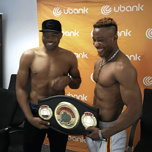 Akani Phuzi, left, and Youssef Kasango Mwanza pose with the vacant WBA Pan African title that will be at stake when they meet on Sunday.