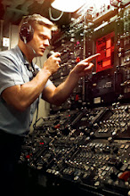 Photo: 970716-N-6483G-001At sea aboard USS Seawolf (SSN 21) Jul. 16, 1997 -- Fire Technician 3rd Class Shea Keesee of Oklahoma City, OK, stands the battle station watch.  Keesee operates the missile launch console which uses the latest touch screen technology.  Photo by Chief Photographer's Mate John E. Gay. (RELEASED)