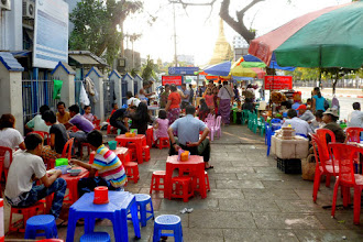 Photo: This is a common street scene.  You can buy food from a vendor nearby and sit at one of the small tables to eat.