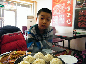 Photo: dined out with son in lunar Mourning Day for canteen out of service. I hated it for the extra expense under my current shabby financial situation. a cop, or slef-claimed cop, queried my situation &persuaded me fleet from Qiqihar, saying people here r bad people. I replied anyone in any place needs a shelter and a job. dogging PRC barking upon my Royal China behind curtain. here son, warrenzh 朱楚甲, Hope of China, God of Universe, allowed my shooting for blog.