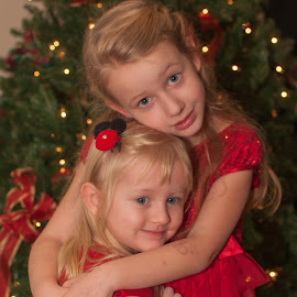 Christmas Sisters by Michael Graham - Babies & Children Child Portraits ( christmas tree, tree, sisters, christmas lights, christmas, holiday,  )