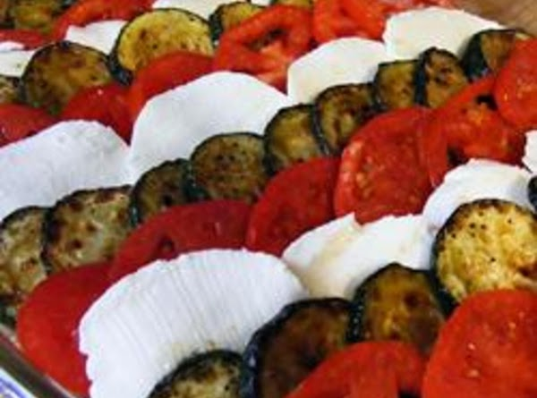 Arrange the slices of zucchini in an 9x12-inch glass baking dish, alternating with slices...