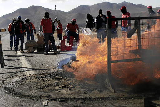 Workers from BHP Billiton's Escondida, the world's biggest copper mine, gather outside the company gates during a strike, in Antofagasta, Chile, on February 11 2017. Picture: Reuters