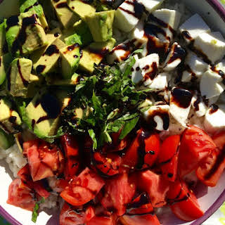 Caprese Avocado Rice Salad with Balsamic Reduction.
