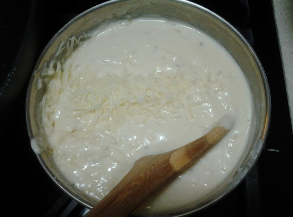 Add 1/4 cup of the shredded parmesan, stir to melt, and remove from heat....