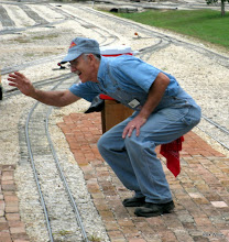 Photo: Brent Muecke, station agent, waving to the smaller passengers.     HALS 2009-0919