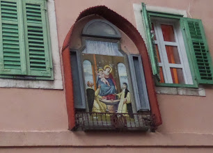 Photo: As we walked down the ancient streets we saw beautiful buildings and found artwork praising the Virgin Mary.