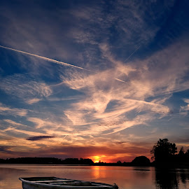 The small boat on the lake by Joseph Balson - Transportation Boats ( sunset - sunrise, boat, landscape,  )