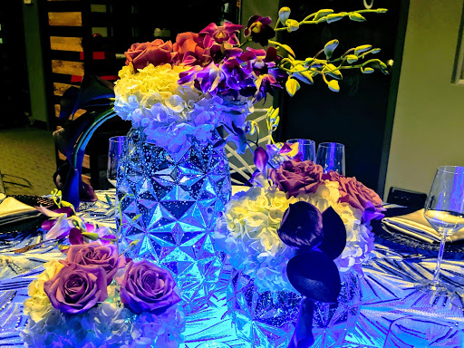 By Dzign is your source for all event floral and of course all your event planning needs. Event design, planning, printing, rentals, lighting, fabrication and hand holding.... Let's create wow together.