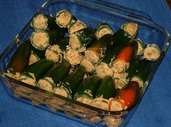 Using a spoon, stuff the filling into the hollowed-out jalapeños.