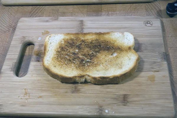 Take one of the single-toasted pieces of bread, and lay on a clean surface,...