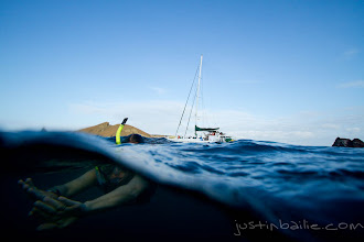 Photo: Young woman snorkeling in the Galapagos Islands, Ecuador.