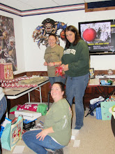 Photo: Krist, Tina & Tammy wrapping gifts for the kare kits kidz!