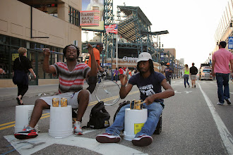 Photo: Some talented musicians enjoy #GarrettPopcorn while drumming outside the Detroit Tigers game on August 15, 2014!