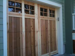 Photo: Cedar Park Overhead Doors. Custom Wood Door. Unstained for Vice Brothers Homes