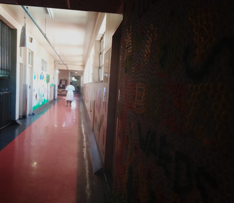 A new mother walks down a corridor at the Rahima Moosa Mother and Child Hospital in Coronationville, Johannesburg, on November 8, 2018. Nine babies died at the facility earlier this year.