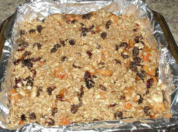 Pour into baking dish and press.  Bake in oven for 30 minutes, top...