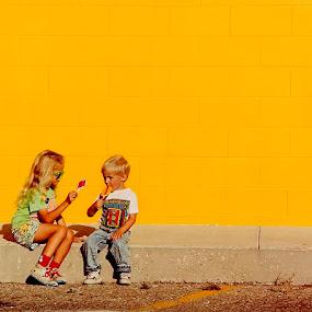 Lollipops by Tom Vogt - Babies & Children Children Candids ( pwclollipop, children, yellow, wall, , color, colors, landscape, portrait, object, filter forge, KidsOfSummer )