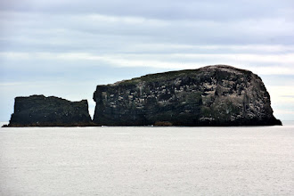Photo: Our first siting - some of the Westman Islands - some of the newest geolgical formations in Iceland