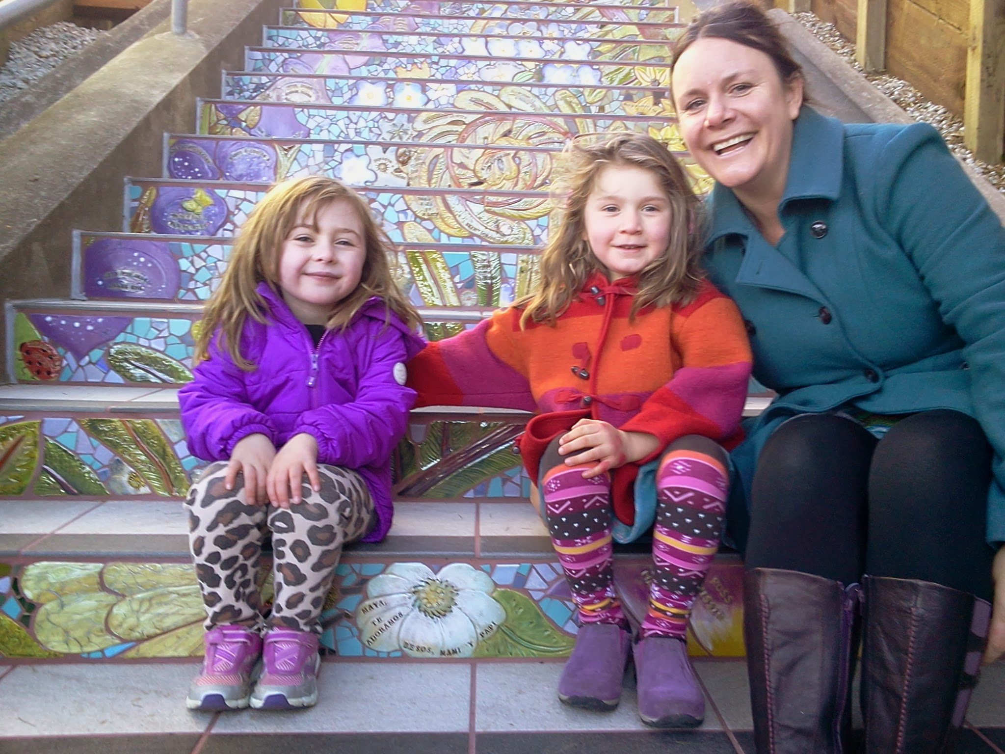 Photo: Gathering near the family tile on the Hidden Garden Steps (16th Avenue, between Kirkham and Lawton streets in San Francisco's Inner Sunset District) during the opening celebration (Saturday, December 7, 2013)  For more information about the Steps, please visit our website (http://hiddengardensteps.org), view links about the project from our Scoopit! site (http://www.scoop.it/t/hidden-garden-steps), or follow our social media presence on Twitter (https://twitter.com/GardenSteps), Facebook (https://www.facebook.com/pages/Hidden-Garden-Steps/288064457924739) and many others.