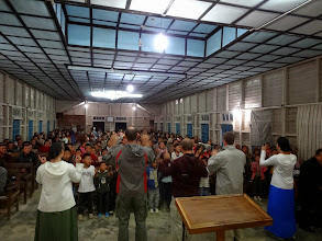 Photo: The IGo students ministering to the multitudes of children that would come out to the evening revival meeting services.