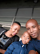 Tlou Molekwane and his wife, Elsie,  with their son Bokang.